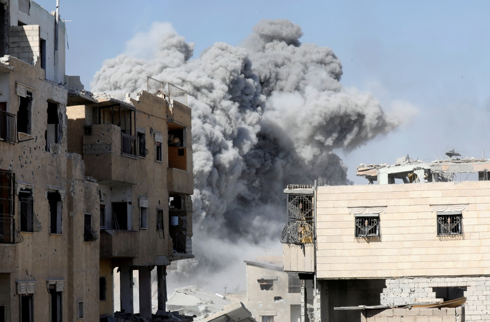 Smoke rises at the positions of Daesh militants after an airstrike by the coalition forces in Raqqa.