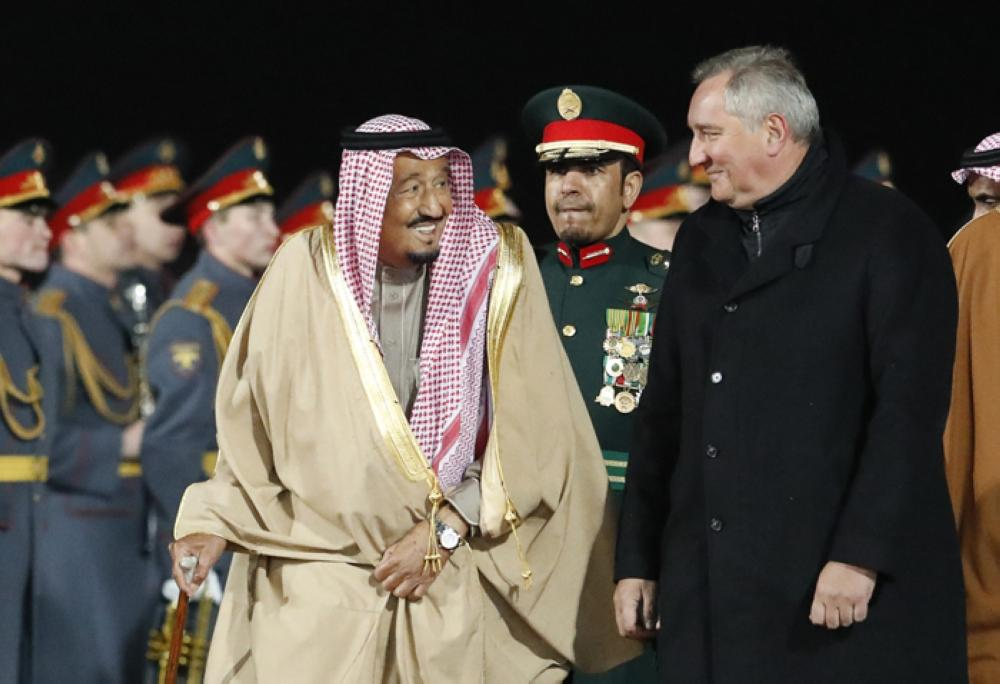King Salman speaks with Russian Deputy Prime Minister Dmitry Rogozin during a welcoming ceremony at Vnukovo airport outside Moscow, Thursday. — Reuters