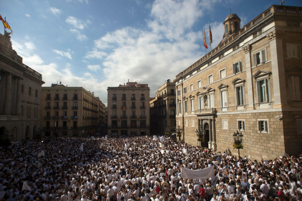 """Protesters attend a demonstration called by the """"Let's talk"""" (Parlem,Hablemos), association for dialogue in Catalonia, in Barcelona, on Saturday. — AFP"""