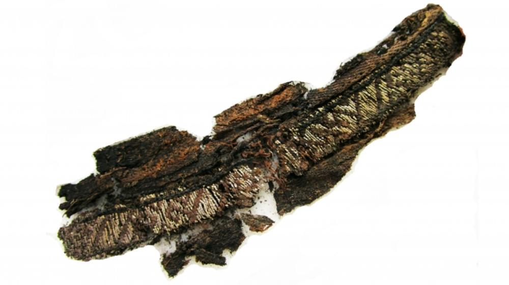 Excavated fragments of a woven band discovered at the Swedish sites. — Courtesy photo