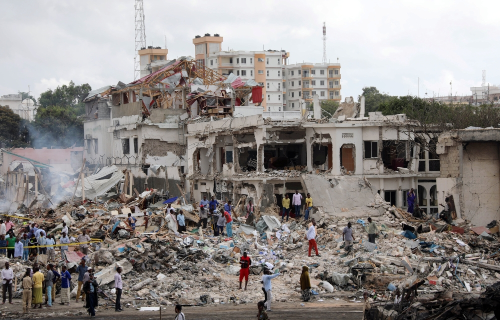Somali government forces and civilians gather at the scene of an explosion in KM4 street in the Hodan district of Mogadishu, Somalia, on Sunday. — Reuters