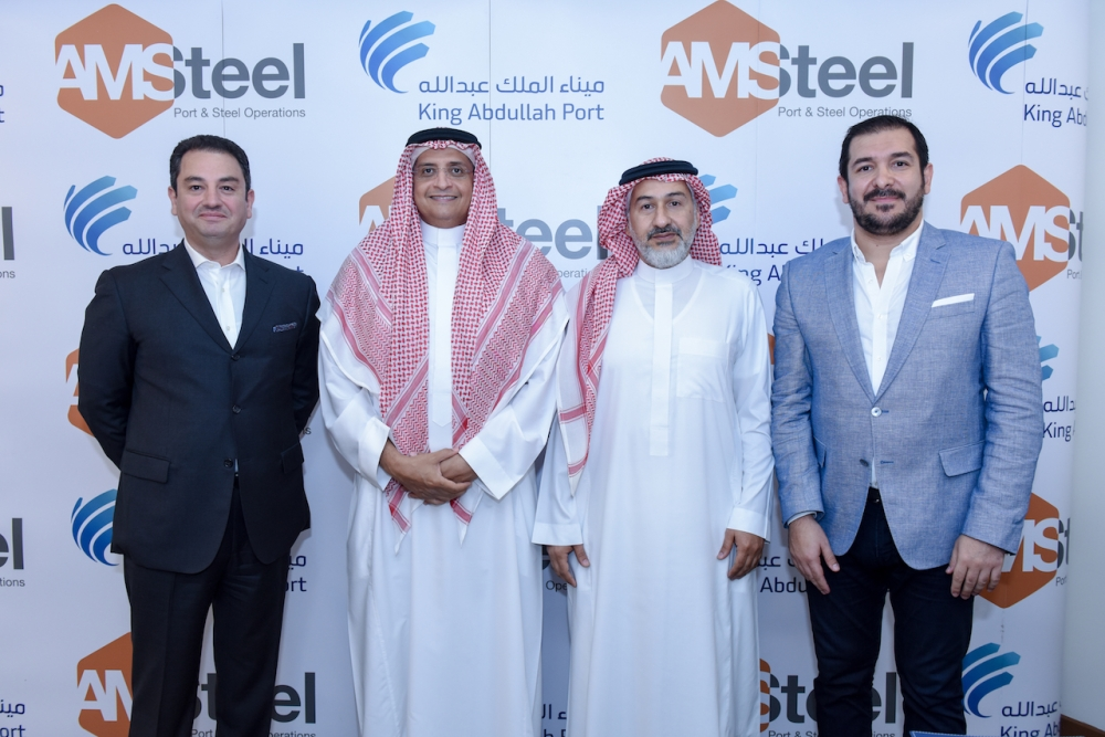 Eng. Abdullah M. Hameedadin, Managing Director of the Ports Development Company; Hassan Al-Attas, Chairman of AMSteel, with other company officials at the signing of agreement