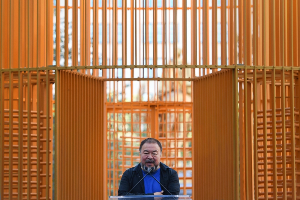Chinese Artist Ai Weiwei delivers a speech as attends his art installation exploring migration titled