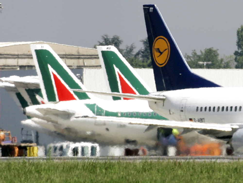 In this file photo, Lufthansa and Alitalia jetliners are parked at the Milan Linate airport, Italy. The Italian daily Corriere della Sera said Lufthansa is preparing a 500 million-euro ($590 million) bid for large parts of bankrupt Italian carrier Alitalia, including the fleet, pilots, air crew and air slots. Alitalia, which declared bankruptcy in May, faces a Monday deadline for binding offers. — AP