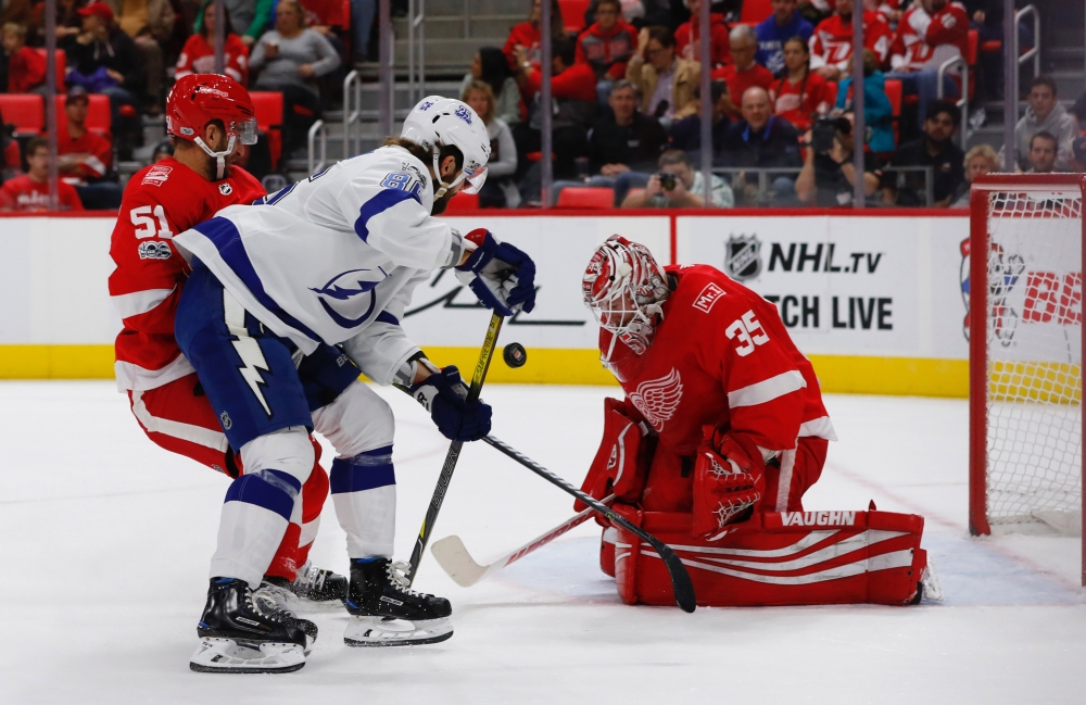 Detroit Red Wings goalie Jimmy Howard (35) makes a save against Tampa Bay Lightning right wing Nikita Kucherov (86) in the first period at Little Caesars Arena. — Reuters