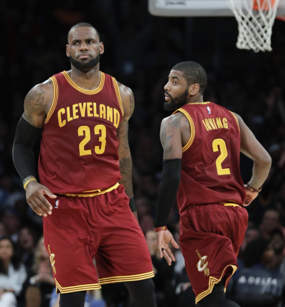 In this file photo, Cleveland Cavaliers' LeBron James, left, greets Kyrie Irving during the second half of an NBA basketball game against the Los Angeles Lakers in Los Angeles. Irving was traded to the Bostons Celtics and returns to Cleveland to play against the Cavaliers, on Tuesday. — AP