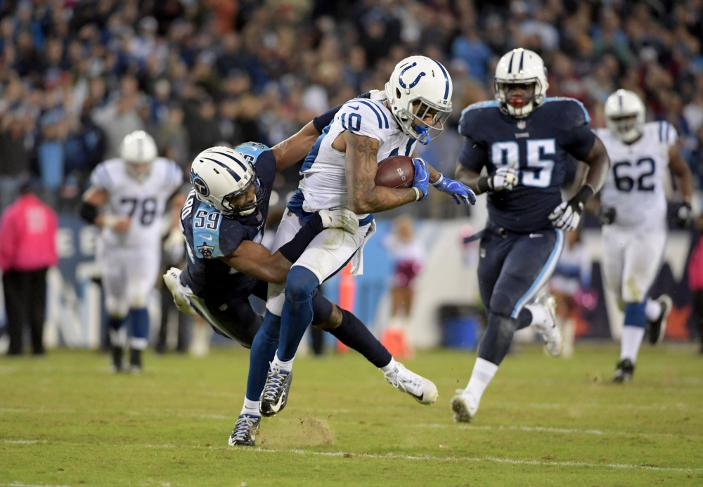 Indianapolis Colts wide receiver Donte Moncrief (10) is tackled by Tennessee Titans linebacker Wesley Woodyard (59) at Nissan Stadium. The Titans defeated the Colts 36-22. — Reuters