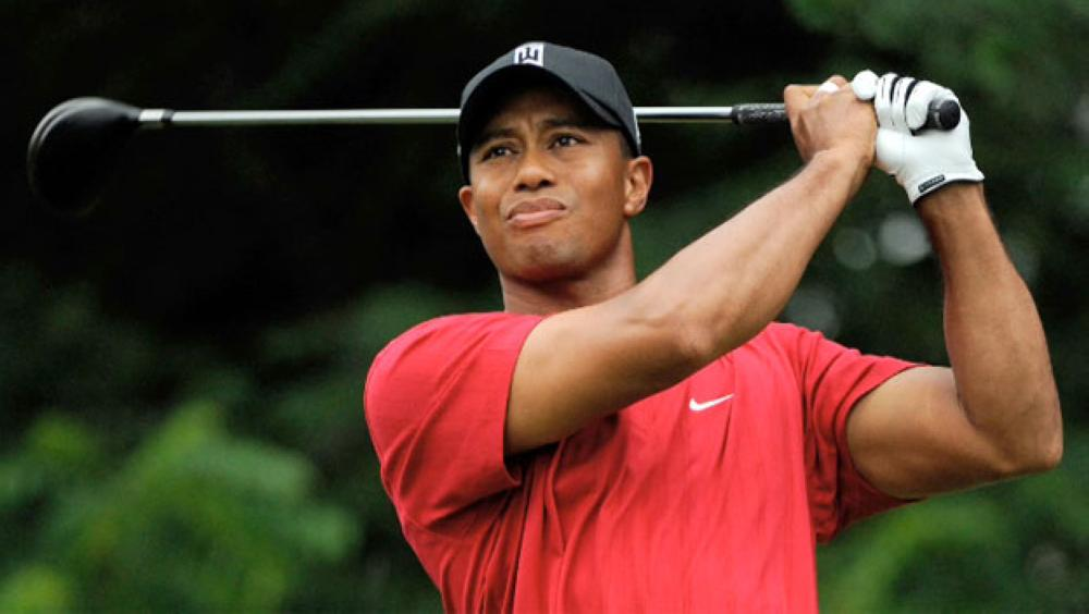 Tiger Woods, seen in this file photo, has tantalized fans with a Twitter video of himself hitting a driver on Sunday and has been cleared by doctors to resume full golf activities.