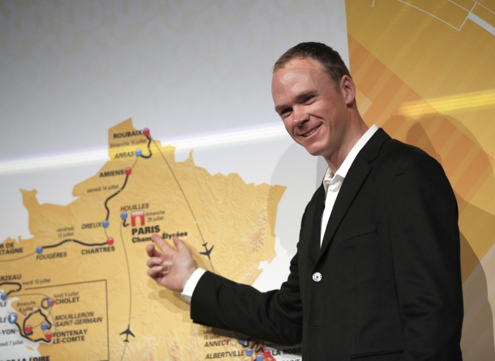 Britain's Chris Froome poses in front of the the road-map during the presentation of the 2018 Tour de France cycling race, in Paris, Tuesday. The 105th edition of the race starts on July 7 2018 to end on the Champs-Elysees avenue on July 29. — AP