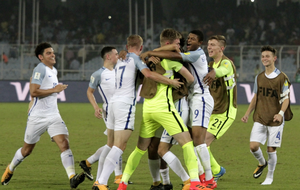 England's footballers celebrate their victory over Japan in their FIFA U-17 World Cup match in Kolkata, India, Tuesday. — AP