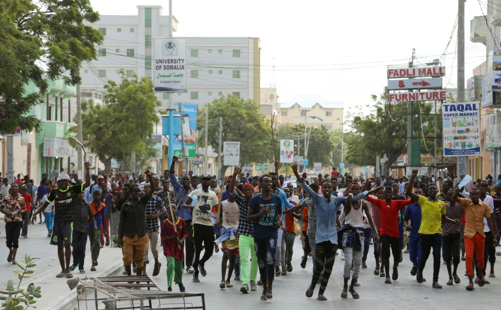 Protesters chant slogans while demonstrating against last weekend's explosion in KM4 street in the Hodan district in Mogadishu, Somalia, on Wednesday. — Reuters