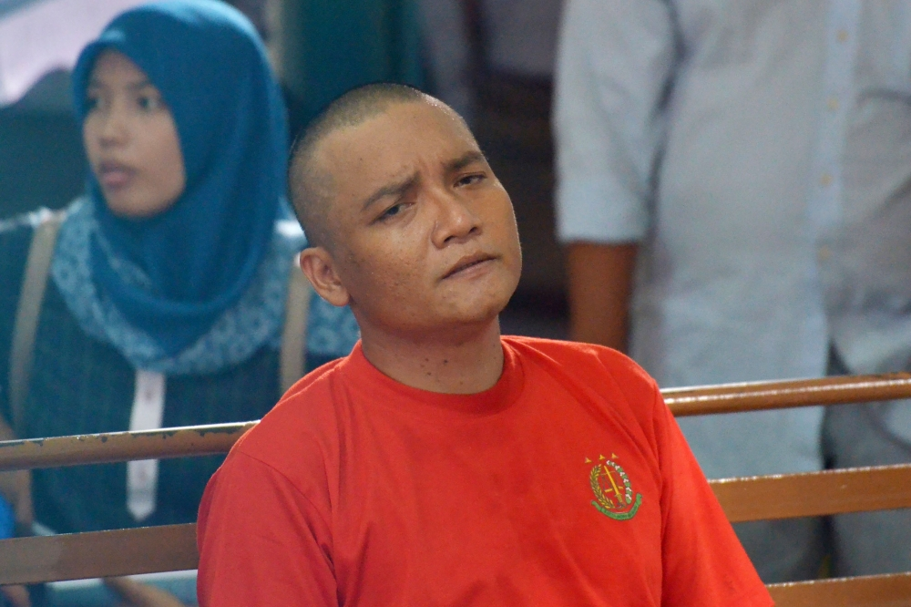 Khaireyll Benjamin Ibrahim, alias Benjy, attends his trial at a court in Medan, Indonesia on Wednesday. - AFP
