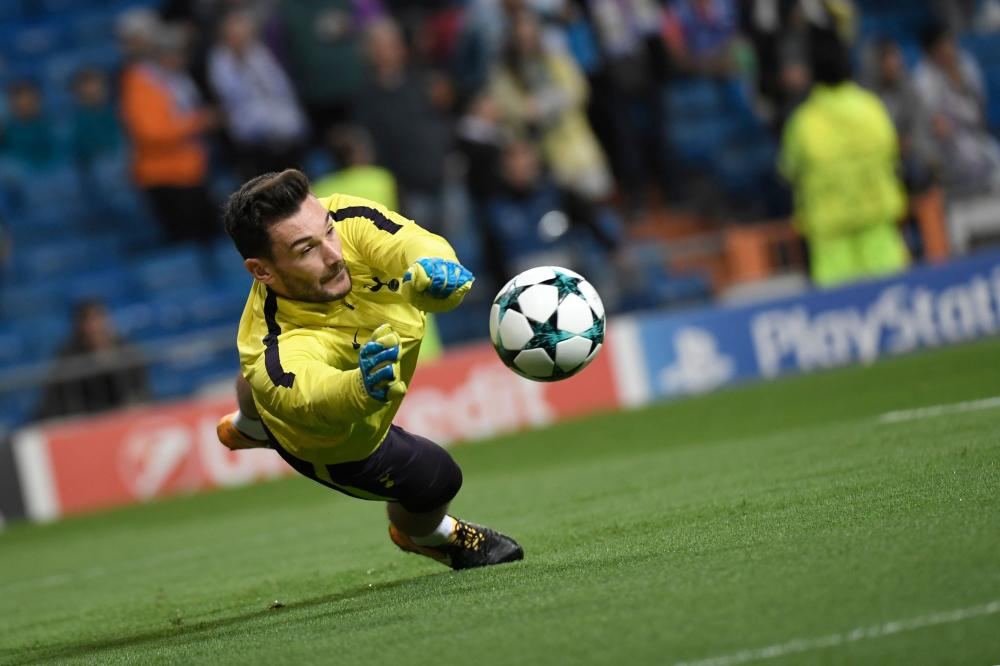 Tottenham Hotspur's French goalkeeper Hugo Lloris dives for the ball during their game against Real Madrid at the Santiago Bernabeu Stadium in Madrid Tuesday. — AFP
