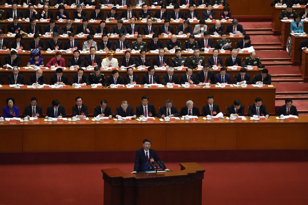 China's President Xi Jinping gives a speech at the opening session of the Chinese Communist Party's five-yearly Congress at the Great Hall of the People in Beijing on Wednesday. — AFP