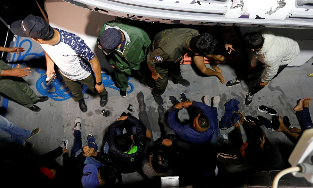 Migrants are seen on a boat after they were rescued earlier this month by Tunisian coast guard off the coast of Bizerte, Tunisia.  — Reuters