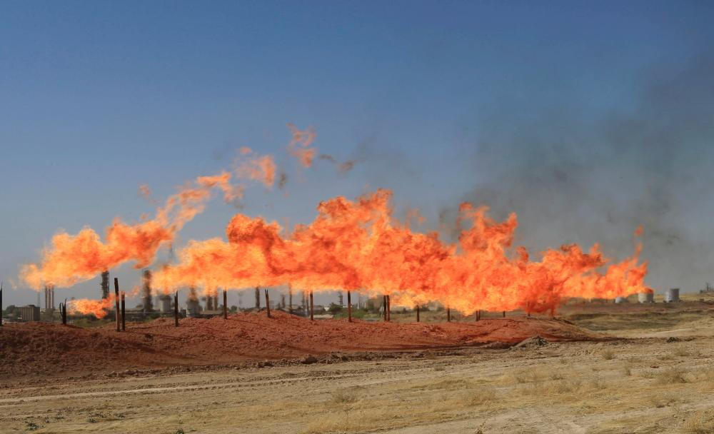 Flames emerge from flare stacks at the oil fields in Kirkuk, Wednesday. — Reuters