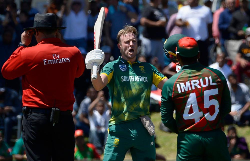 South Africa's AB de Villiers (C) celebrates after scoring a century during the second One-Day international cricket match againt Bangladesh at Boland Park in Paarl Wednesday. — AFP