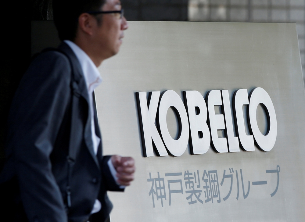 A man walks past the signboard of Kobe Steel at the group's Tokyo headquarters in Tokyo, Japan in this file photo. — Reuters