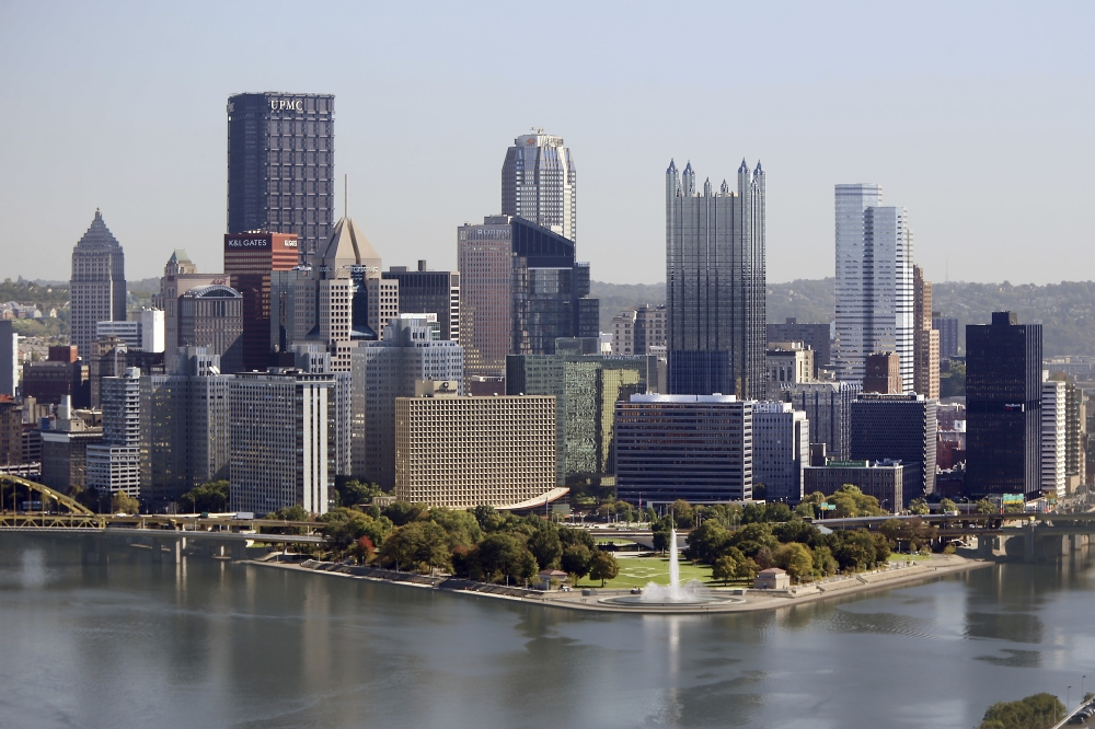 The Pittsburgh skyline is seen from the West End Overlook, a city park, Wednesday. Pittsburgh is one of dozens of cities working frantically to land Amazon's second headquarters. Amazon is promising $5 billion of investment and 50,000 jobs over the next decade and a half. Yet the winning city would have to provide Amazon with generous tax breaks and other incentives. — AP