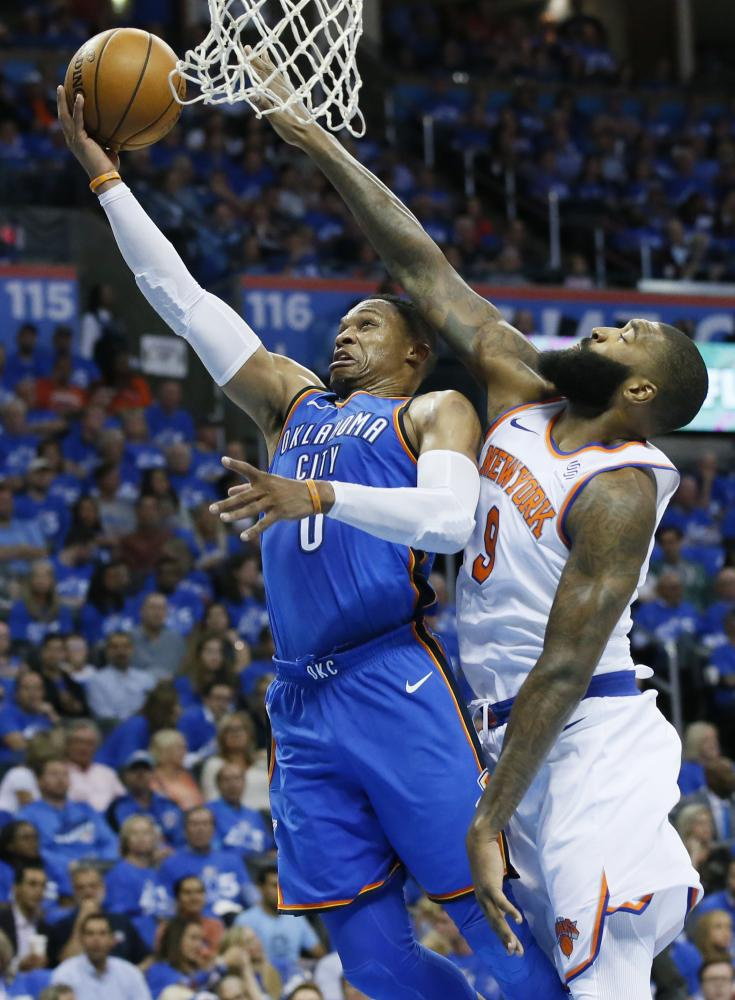 Oklahoma City Thunder's guard Russell Westbrook shoots in front of New York Knicks' center Kyle O'Quinn during their NBA game in Oklahoma City Thursday. — AP