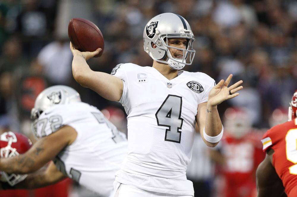 Oakland Raiders' quarterback Derek Carr throws the ball against the Kansas City Chiefs duringtheir NFL game at Oakland Coliseum Thursday. — Reuters