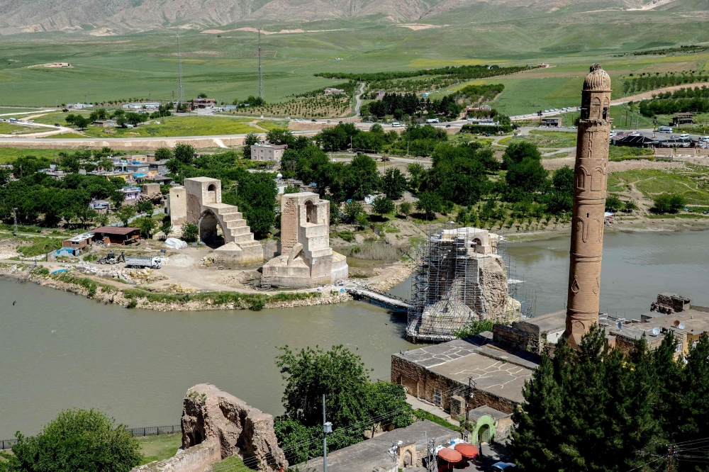A picture taken in May shows a general view of Hasankeyf bridge across the Tigris River in the Hasankeyf district in Batman. At first glance all is as normal in the Turkish town of Hasankeyf, which as seen the Romans, Byzantines, Turkic tribes and Ottomans leave their mark in some ten thousand years of human settlement. The Tigris River languidly flows through the historic center of the town in southeast Turkey's Batman province, souvenir sellers seek to offer their wares to a handful of tourists who pass by and the famous vista of minarets, the citadel and ruined bridge take the breath away. — AFP photos