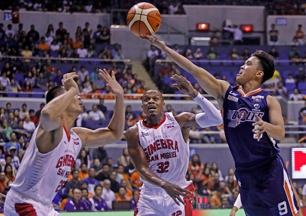 Meralco's Baser Amer attacks the Ginebra frontline of Japeth Aguilar and Justin Brownlee with a teardrop in Game 4 of the PBA Governors' Cup at the Smart-Araneta Coliseum Friday night.