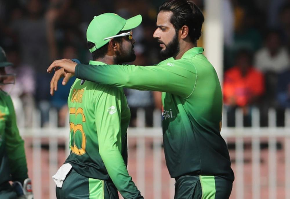 Hasan Ali (R) of Pakistan celebrates with teammate after dismissing Sadeera Samarawickrama of Sri Lanka during the third One-Day International cricket match against Sri Lanka Sharjah Cricket Stadium Friday. — AFP