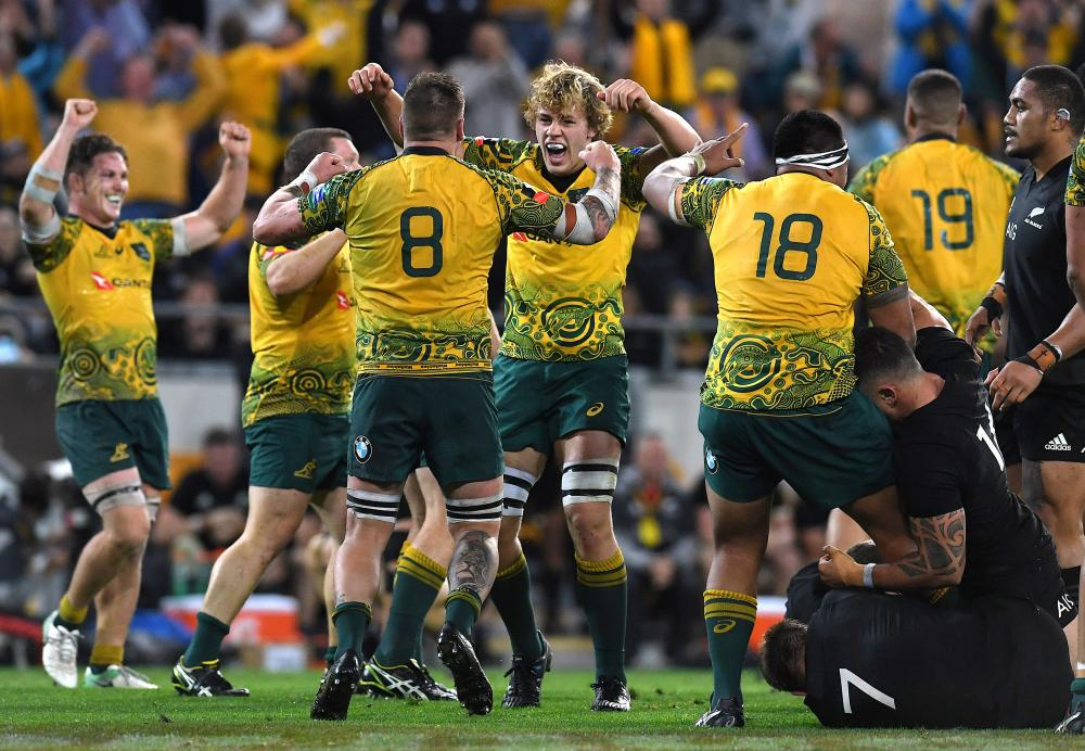 Australian Wallabies players celebrate winning the third Bledisloe Cup rugby union match against the New Zealand All Blacks at Lang Park in Brisbane Saturday. — Reuters