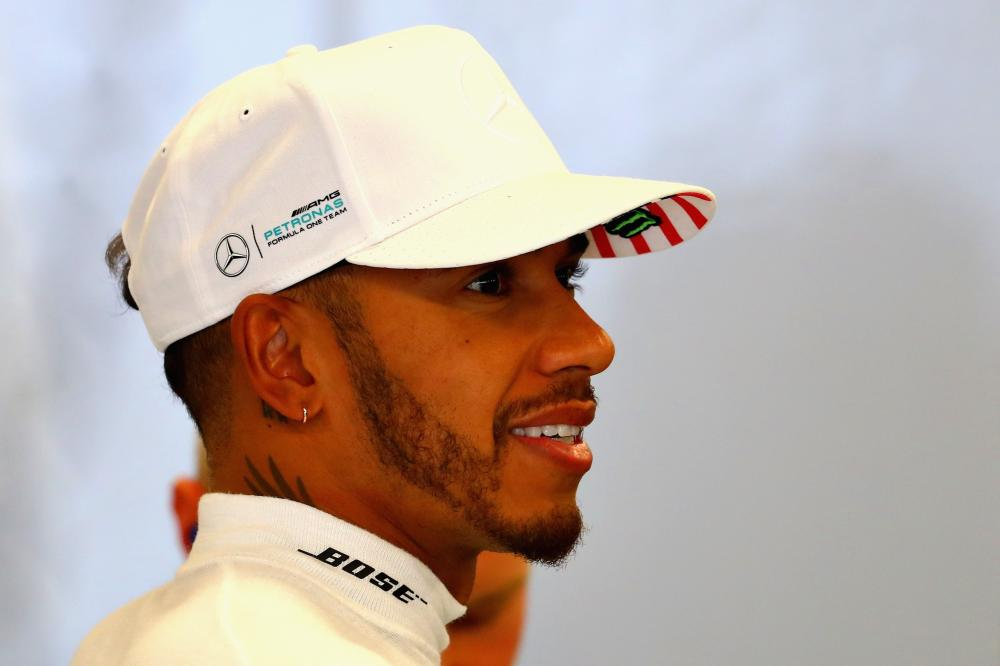 Lewis Hamilton of Mercedes GP prepares to drive in the garage during practice for the US Formula One Grand Prix at Circuit of The Americas in Austin, Texas, Friday. — AFP