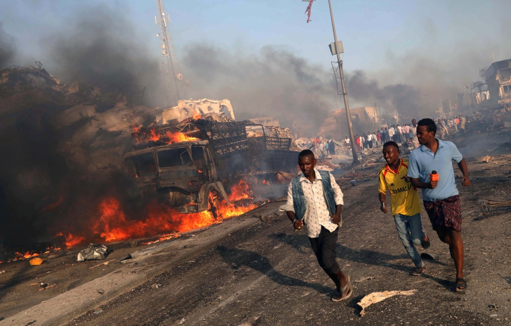 Civilians evacuate from the scene of an explosion in KM4 street in the Hodan district of Mogadishu in this file photo. — Reuters
