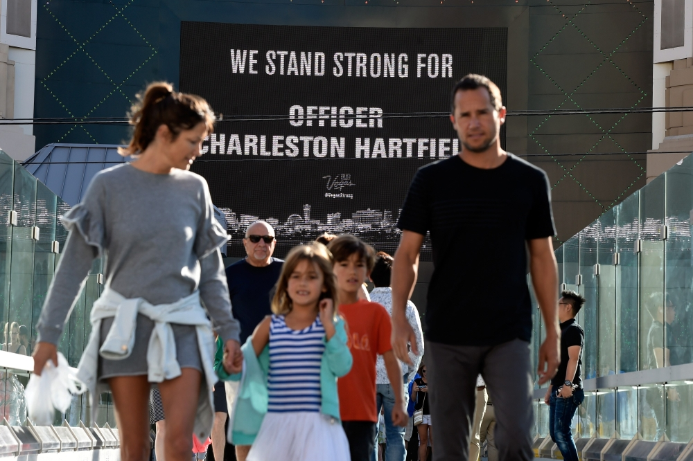 A shop marquee displays support for Las Vegas Metropolitan Police Department Officer Charleston Hartfield during a motorcade on the Las Vegas Strip escorting his body to his funeral in Las Vegas, Nevada. Hartfield, 34, was killed on October 1, 2017, during the massacre at the Route 91 Harvest country music festival when Stephen Paddock opened fire on the crowd killing 58 people and injuring more than 500. — AFP