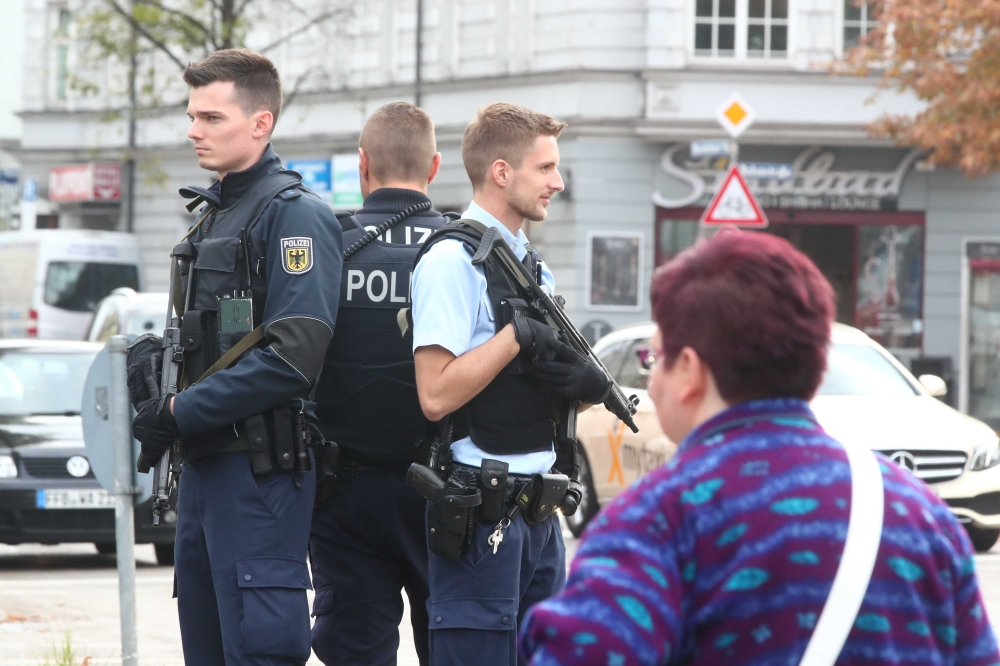German police officers guard the site where earlier on Saturday a man injured several people in a knife attack in Munich, Germany. — AFP