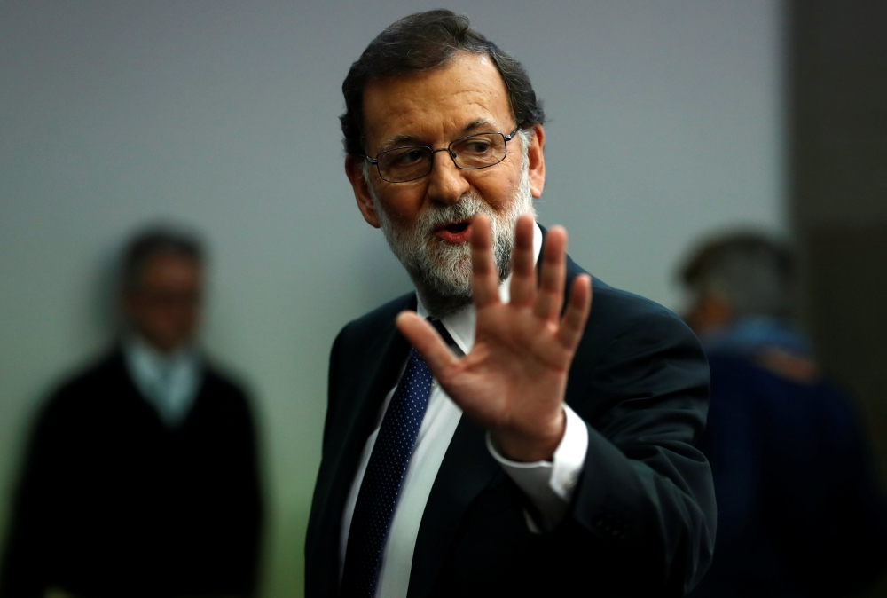 Spain's Prime Minister Mariano Rajoy leaves after a press conference at the Moncloa Palace in Madrid, Spain, on Saturday. — Reuters