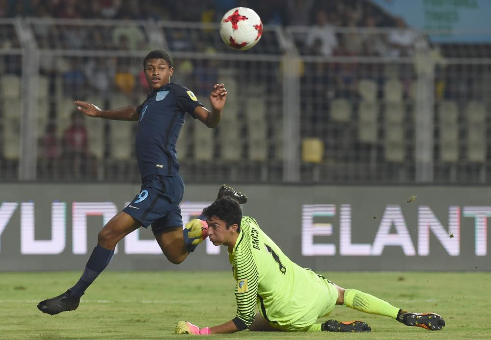 Rhian Brewster of England scores past goalkeeper Justin Garces of US during their quarterfinal match of the FIFA U-17 World Cup at the Jawaharlal Nehru Stadium in Goa, India, Saturday. — AFP