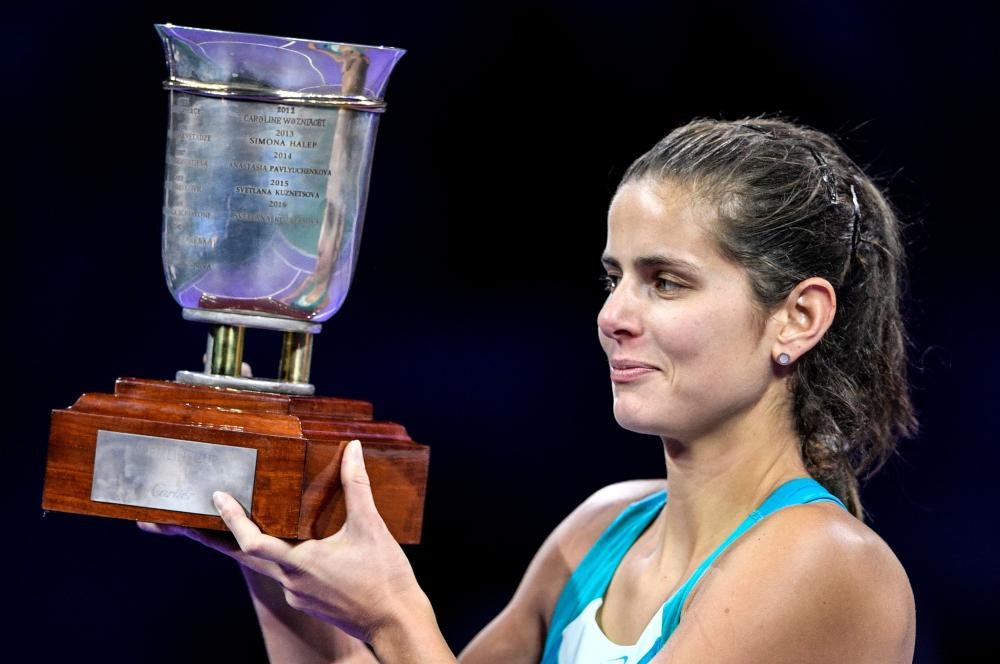Germany's Julia Goerges poses with the trophy after beating Russia's Daria Kasatkina in the final of the Kremlin Cup Tennis Tournament in Moscow Saturday. — AFP