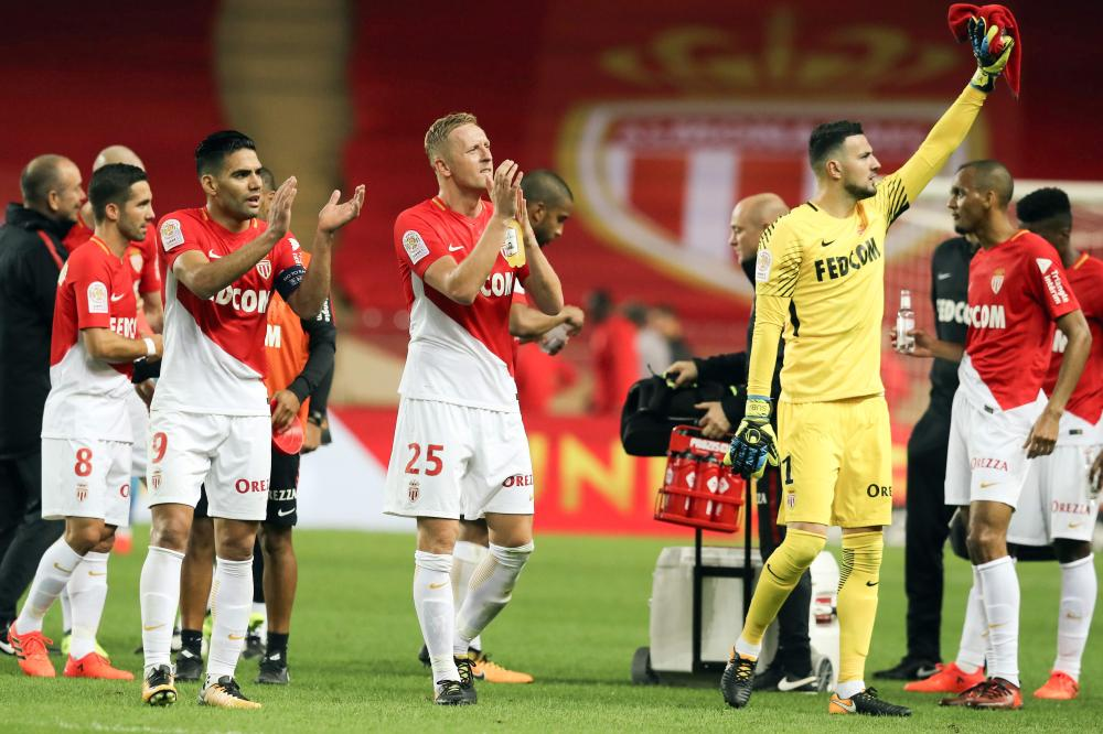 Monaco's players celebrate their victory in the French L1 football match against Caen at the Louis II Stadium in Monaco Saturday. — AFP