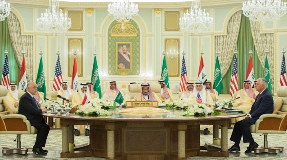 Custodian of the Two Holy Mosques King Salman (C) attends a meeting of the Saudi-Iraqi Bilateral Coordination Council with US Secretary of State Rex Tillerson (R) and Iraqi Prime Minister Haider Al-Abadi (L) in Riyadh on Sunday. — SPA