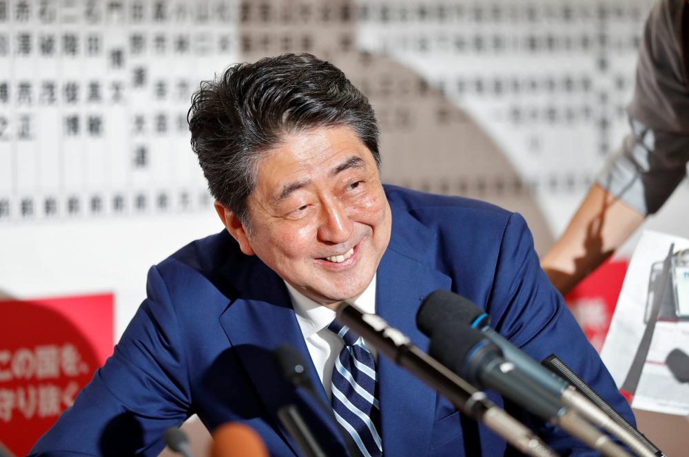 Japan's Prime Minister Shinzo Abe, leader of the Liberal Democratic Party (LDP), smiles during a news conference after Japan's lower house election, at the LDP headquarters in Tokyo, Japan, on Sunday. — Reuters