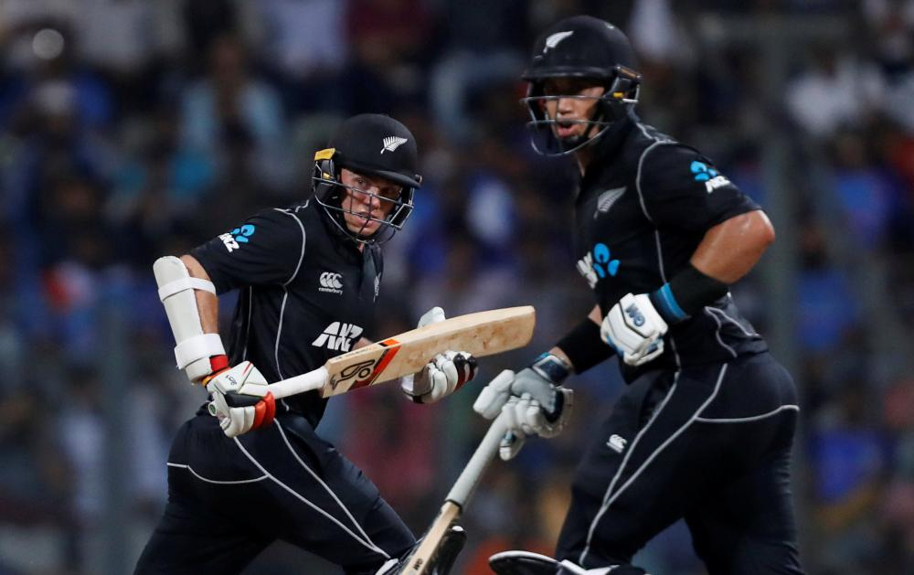 New Zealand's Ross Taylor (R) and Tom Latham run between wickets during the One-Day International cricket match against India in Mumbai Sunday. — Reuters