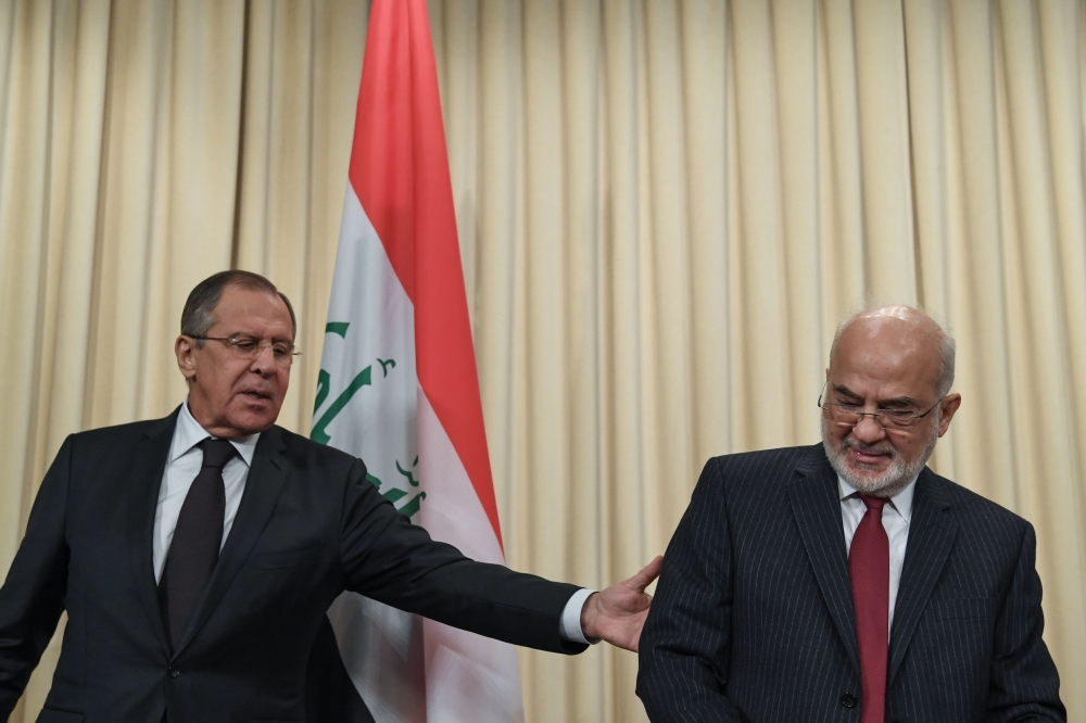 Russian Foreign Minister Sergei Lavrov (L) and his Iraqi counterpart Ibrahim Al-Jaafari leave after a joint press conference following their meeting in Moscow on Monday. — AFP