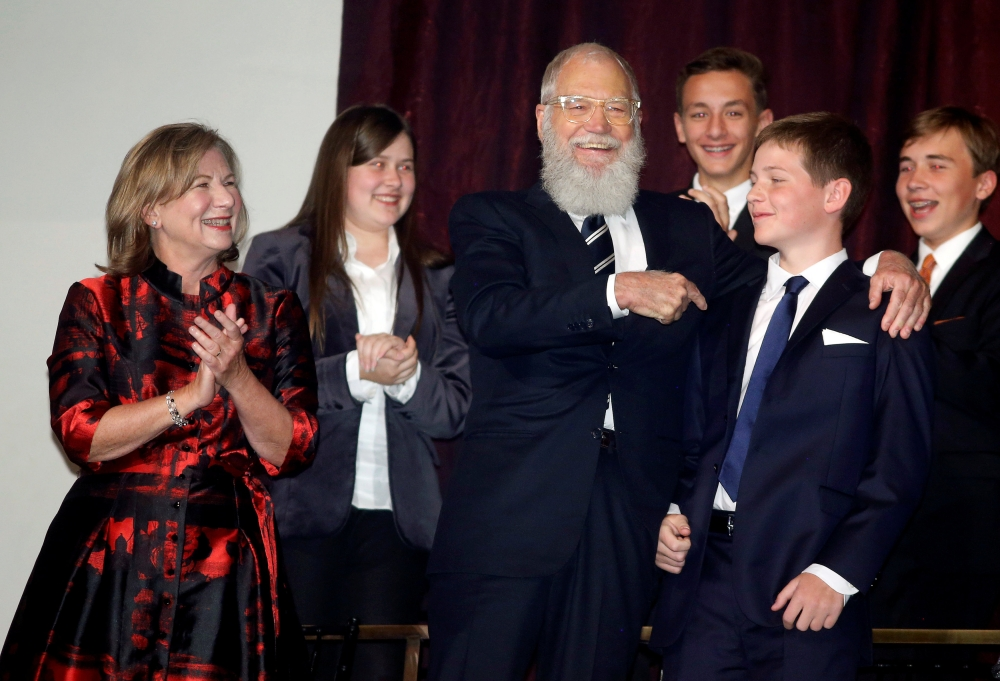Comedian David Letterman greets his son Harry as he arrives for a gala where he received the Mark Twain Prize for American Humor at Kennedy Center in Washington D.C. on Monday. - Reuters