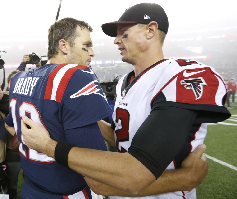 New England Patriots' quarterback Tom Brady (L) greets Atlanta Falcons' quarterback Matt Ryan after the game at Gillette Stadium in Foxborough Sunday. — Reuters