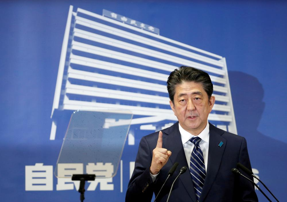 Japan's Prime Minister Shinzo Abe, who is also leader of the Liberal Democratic Party (LDP), attends a news conference at LDP headquarters in Tokyo, Japan, on Monday. — Reuters