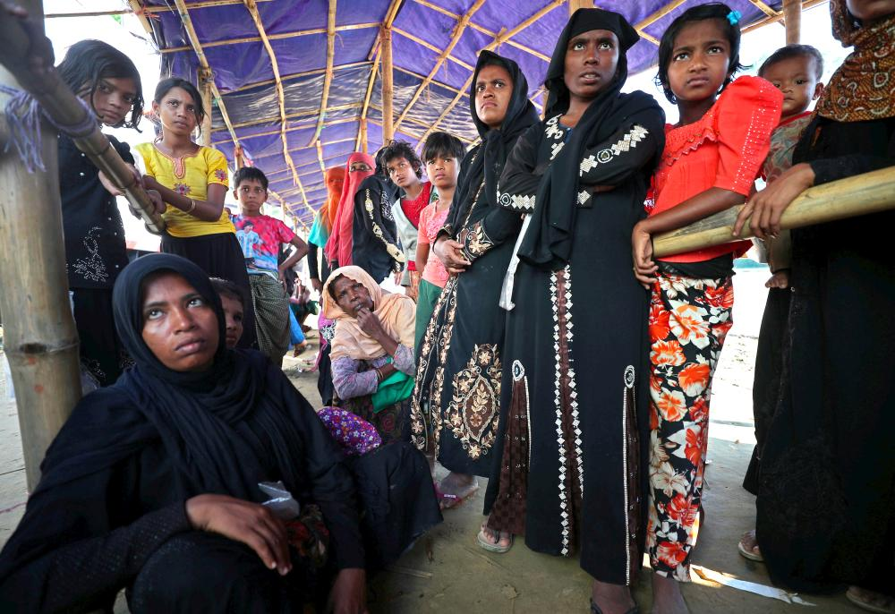 Rohingya refugees line up to receive humanitarian aid in Balukhali refugee camp near Cox's Bazar, Bangladesh, Monday. — Reuters