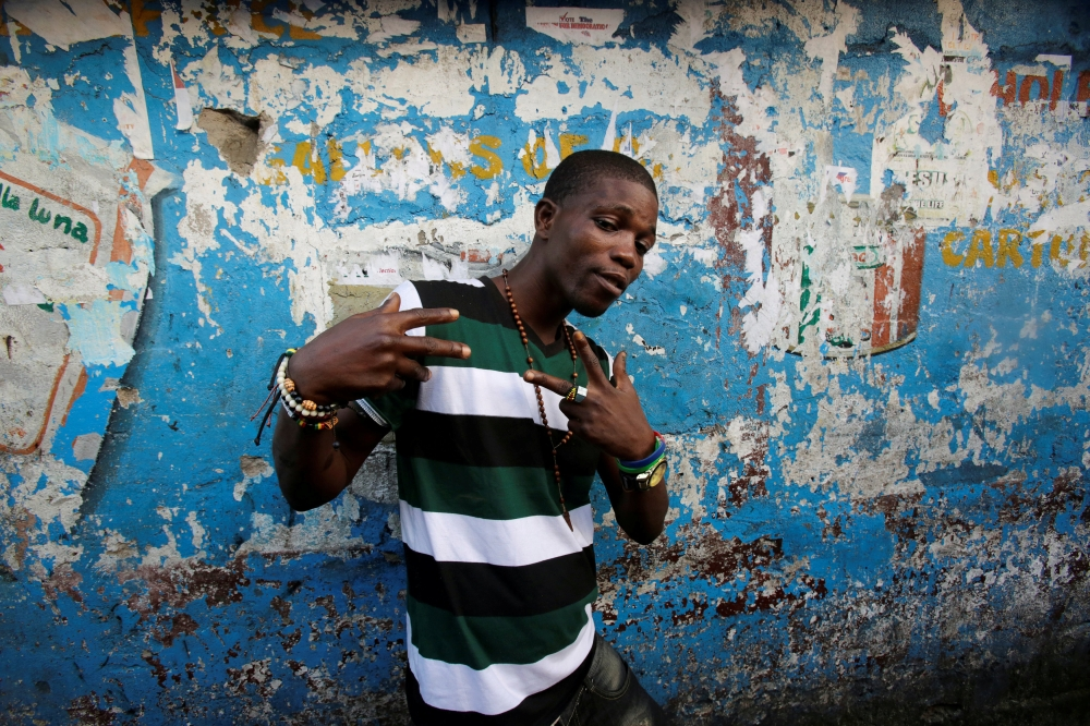 A man poses for pictures in the township of West Point, in Monrovia, Liberia. — Reuters