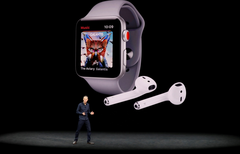 File photo shows Jeff Williams, Apple COO, speaking as product images are shown behind him during a launch event in Cupertino, California, US. — Reuters