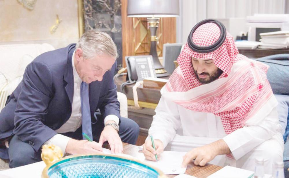 Crown Prince Muhammad Bin Salman, deputy premier and minister of defense and chairman of the Public Investment Fund, signs the appointment papers of Dr. Klaus Kleinfeld as Chief Executive Officer of NEOM. Klaus Kleinfeld was chairman and chief executive officer of Arconic, former chairman and CEO of Alcoa Inc., and former president and CEO of Siemens AG. — SPA