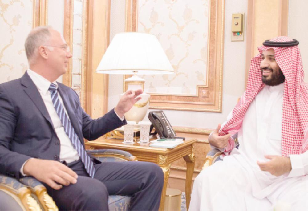 Crown Prince Muhammad Bin Salman, deputy premier and minister of defense, discusses a point with Kirill Dmitriev, CEO of the Russian Direct Investment Fund, in Riyadh, Thursday. — SPA