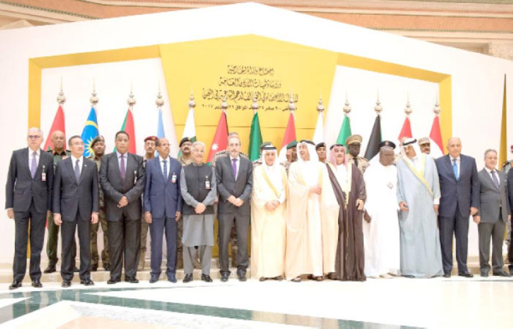 Foreign ministers and chiefs of staff of member states of the Arab Coalition forces in Yemen stand for a group photo before their meeting in Riyadh on Sunday. — SPA